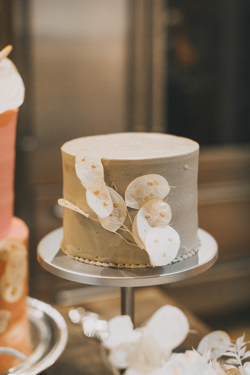 Lovegood Wedding & Event Rentals, New Orleans Vintage Rental Company for Corporate, Parties, and Weddings | Lounge Furniture in NOLA, Specialty Rentals, Decor across the Southeast, Cream Boho Wedding Cake