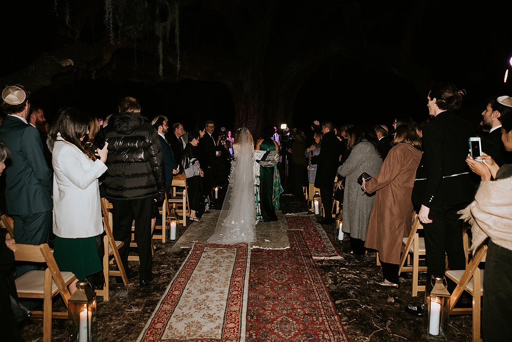 New Orleans' Tree of Life and Audubon Tea Room Wedding with Lovegood Wedding & Event Rentals with Pink Chuppah, Babybreath Floral Boa, and Many More Details  | Lovegood Wedding & Event Rentals, New Orleans Vintage Rental Company for Corporate, Parties, and Weddings | Lounge Furniture in NOLA, Specialty Rentals, Decor across the Southeast, fashion forward bride and groom with assorted aisle of rugs