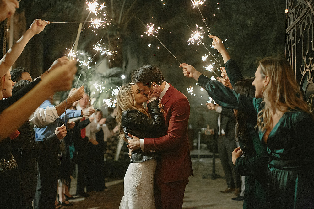 Race & Religious Wedding in New Orleans with Yellow, Pink, and Green Palette with Lovegood Rentals | Race & Religious Wedding in New Orleans with Yellow, Pink, and Green Palette with Lovegood Rentals | Classic Farm Tables, Mismatched Chairs | Sparkler Exit