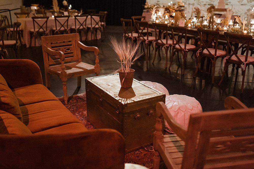 Civic Theatre in New Orleans Featuring Infused Boho Indian Flare, Dried Palm Backdrop, and Lounge Spaces with Lovegood Wedding & Event Rentals | Lovegood Wedding & Event Rentals, New Orleans Vintage Rental Company for Corporate, Parties, and Weddings | Lounge Furniture in NOLA, Specialty Rentals, Decor across the Southeast, Bohemian Reception with Dried Centerpieces