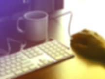 Man's hand at computer with coffee mug