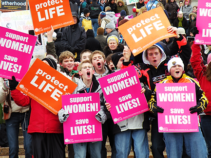 young people holding pro-life signs
