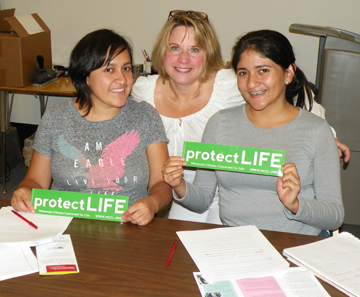 Hispanic volunteers with pro-life bumper stickers