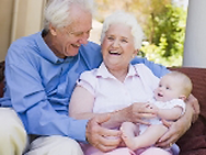 elderly couple and baby