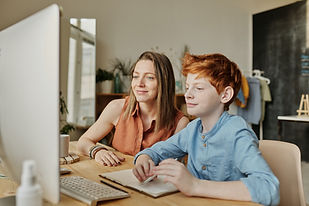 photo-of-woman-and-boy-smiling-while-wat