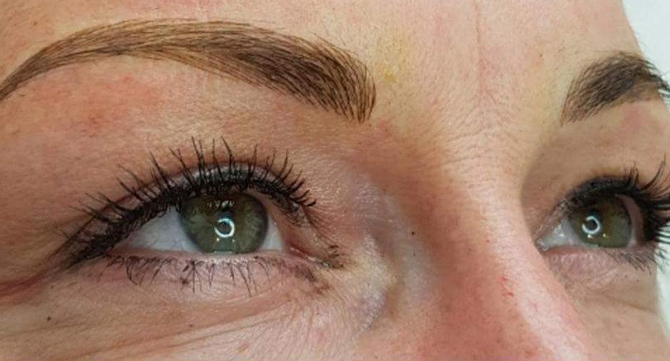 Close up womans eye brows and eyelashes