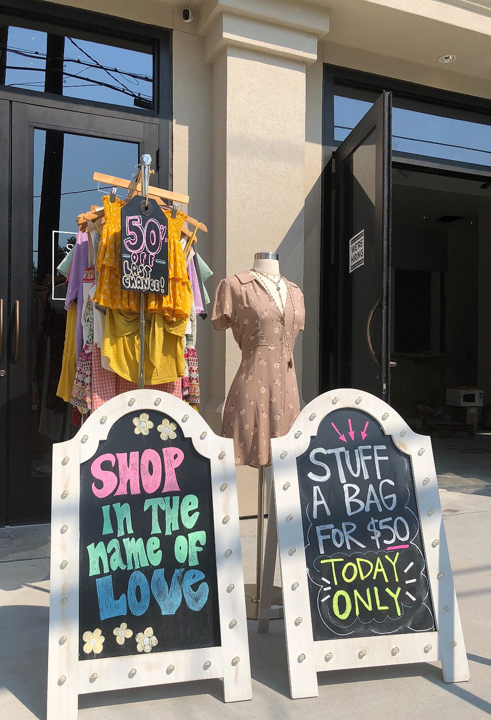 She Metairie retail boutique store from with sales racks