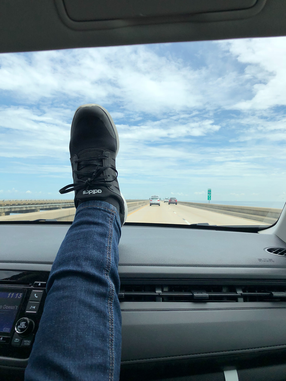 Legs on car interior over the Mandeville Causeway in New Orleans