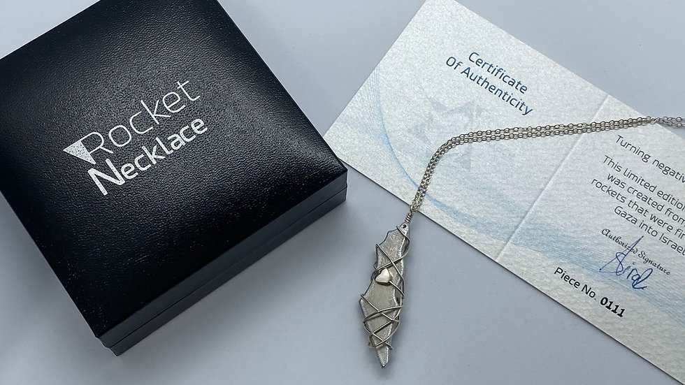 Map Of Israel warped with silver wire with a heart