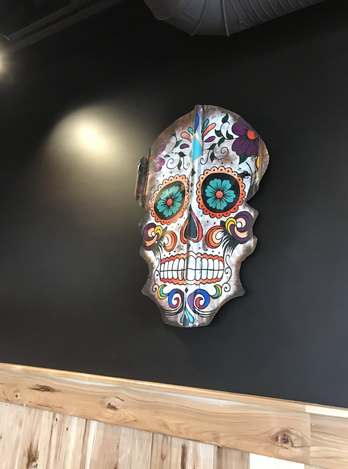 Skull collaboration in it's new home on the wall at Cabeza Grande Tacos & Tequila in the community of Heartland in Cochrane, AB
