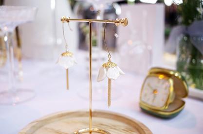 Our Snowdrop Flower Tassel Earrings in 14K gold-filled element.