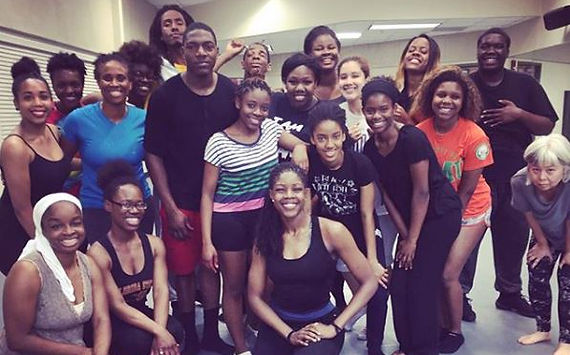 Florida AMU students pause after class with Dayton Cotemporary Dance Company's Qarrinne Blayr during a DCDC HBCU tour