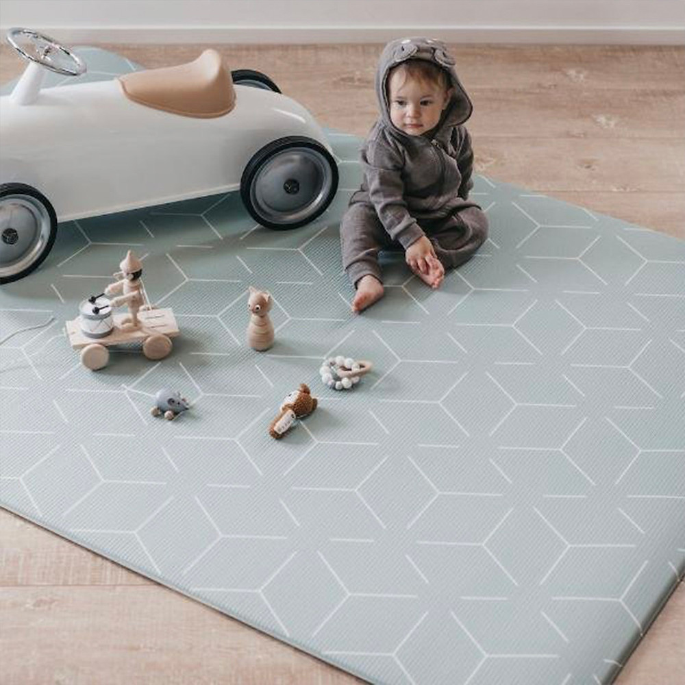 baby playing on little wiwa Signatur Sage Play Mat