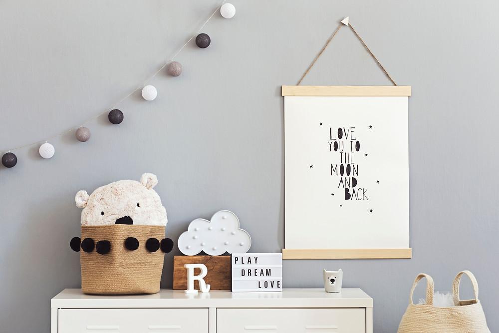 wall photo of a baby nursery in scandinavian gray theme