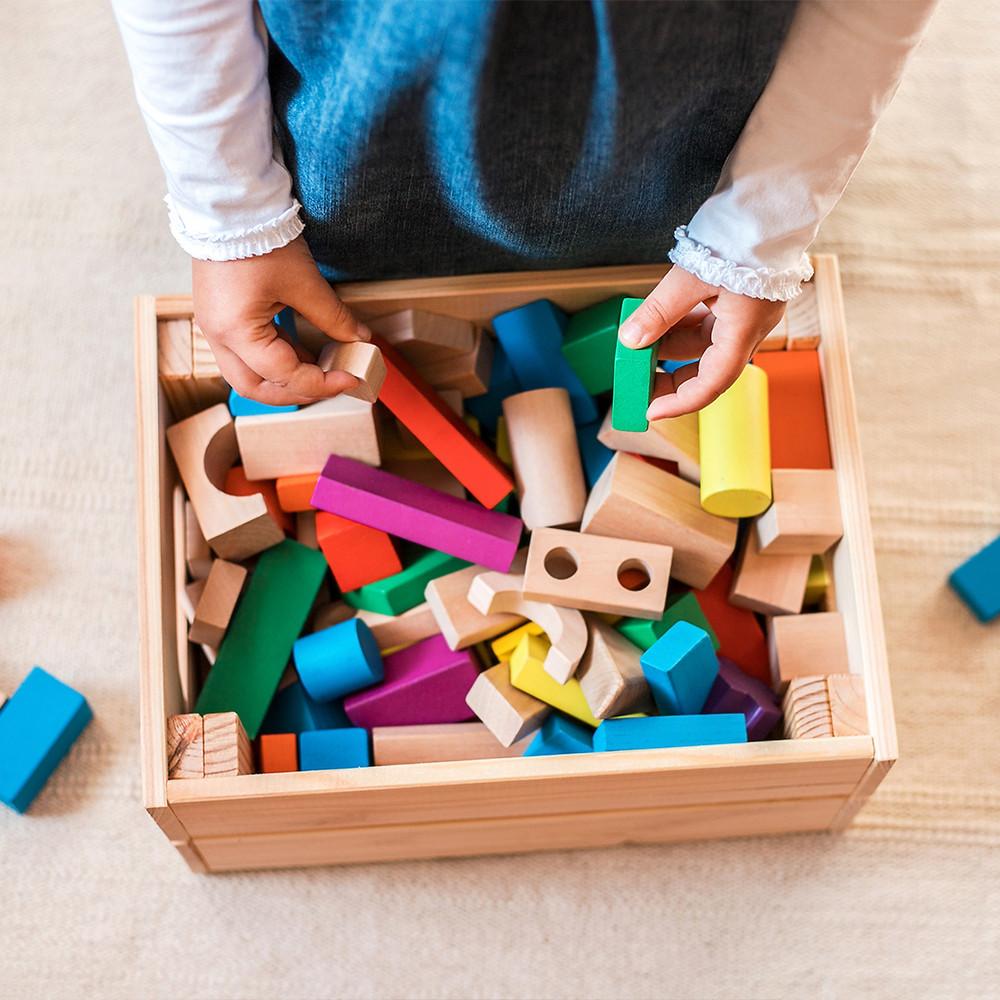 mother organizing toys