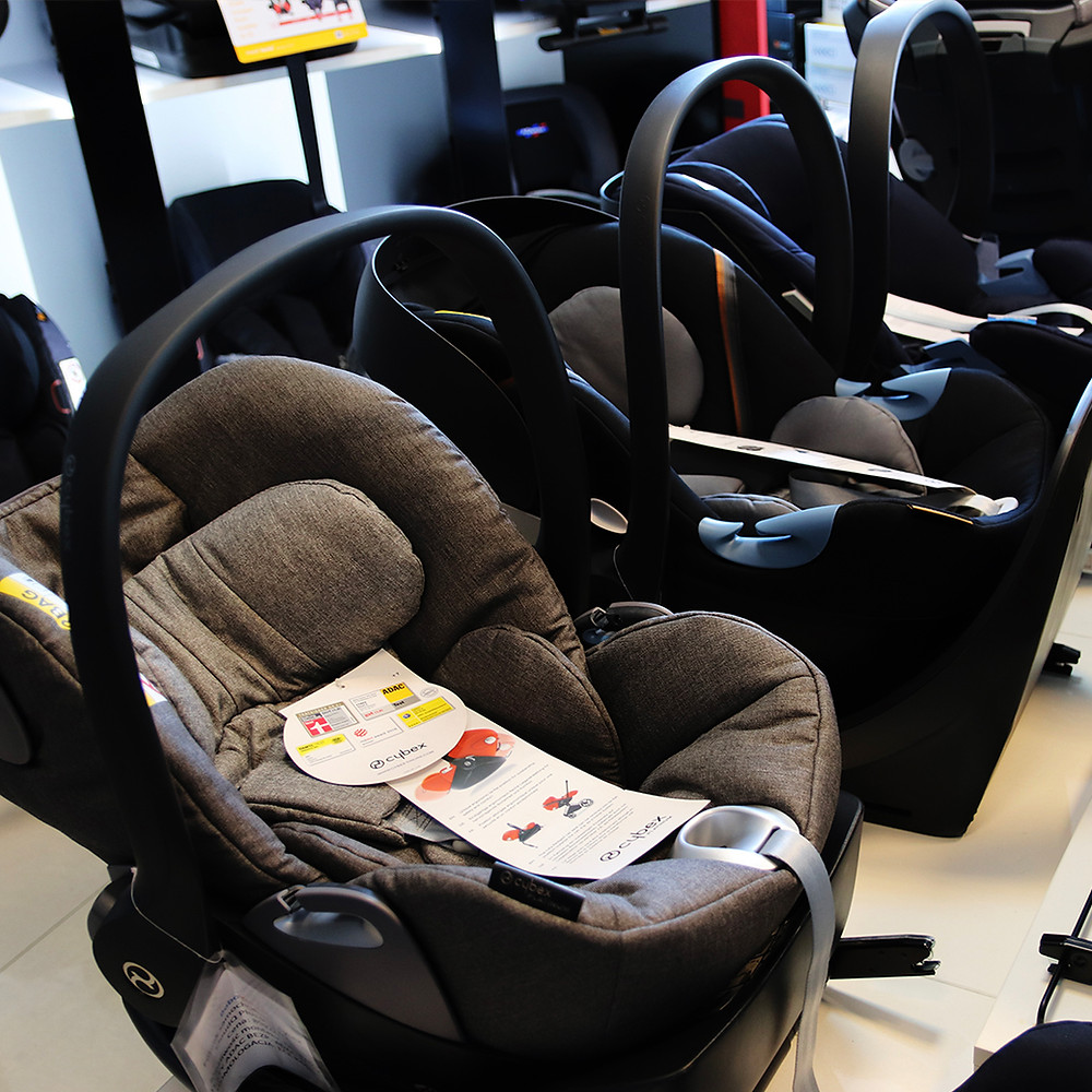 display of baby car seats in store