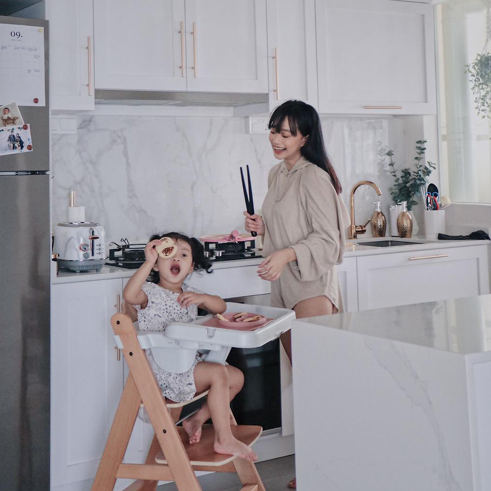 mother and baby having fun at the kitchen
