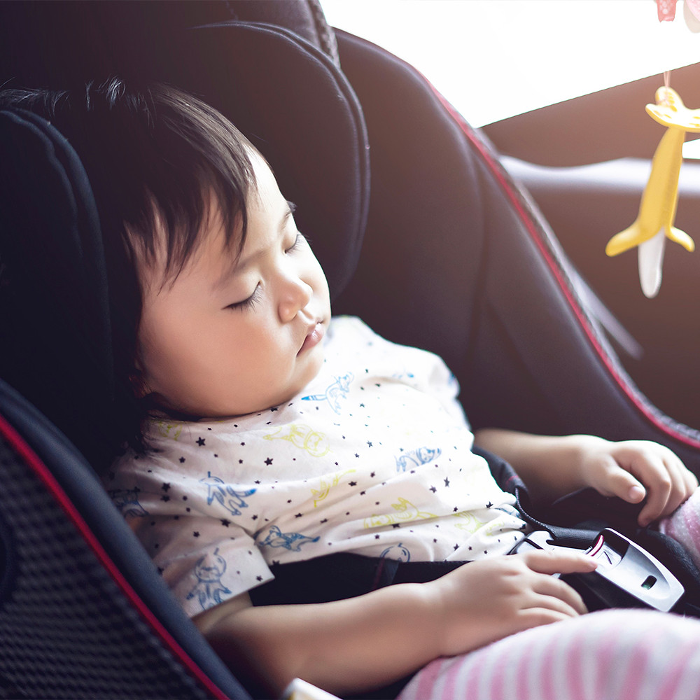 baby sleeping peacefully in her car seat