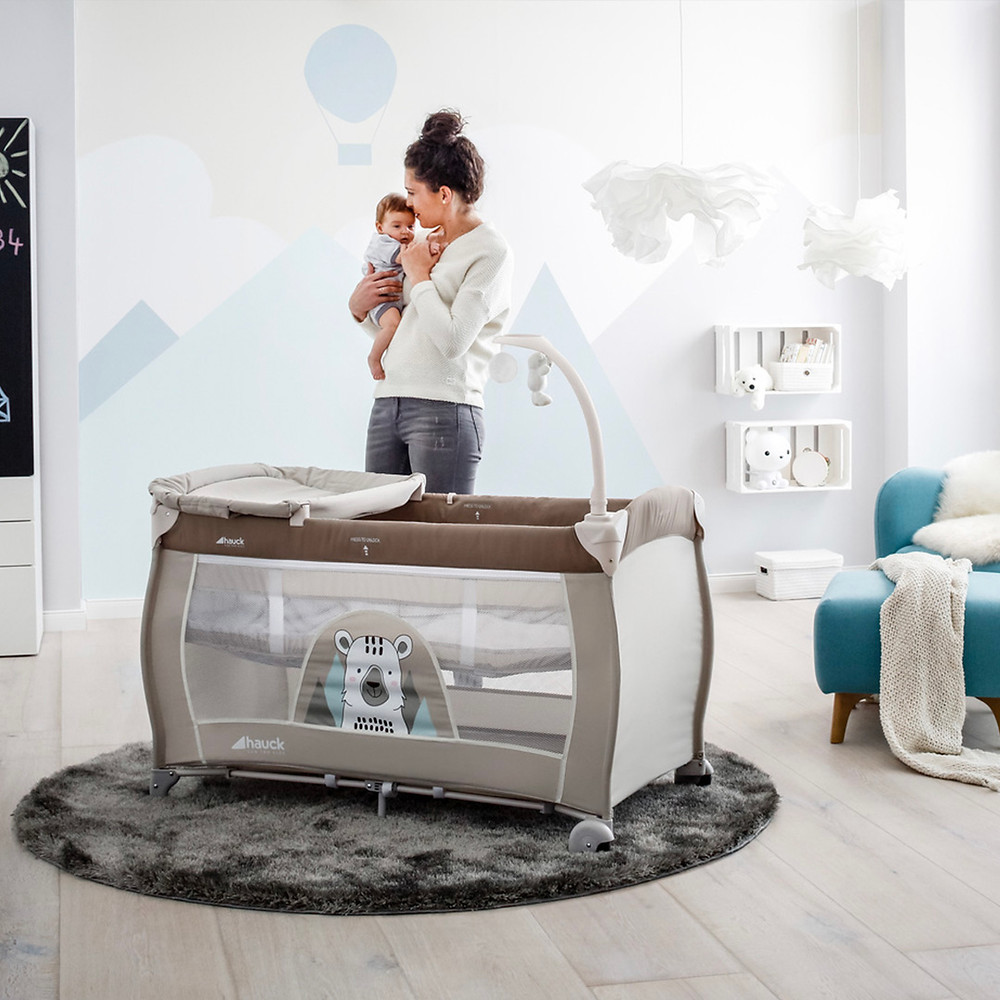 mother and child beside their new hauck babycenter cot