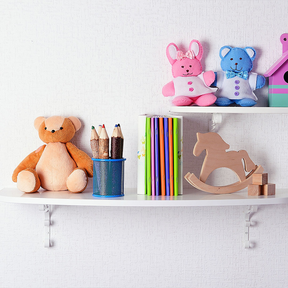 wall shelf with books and toys