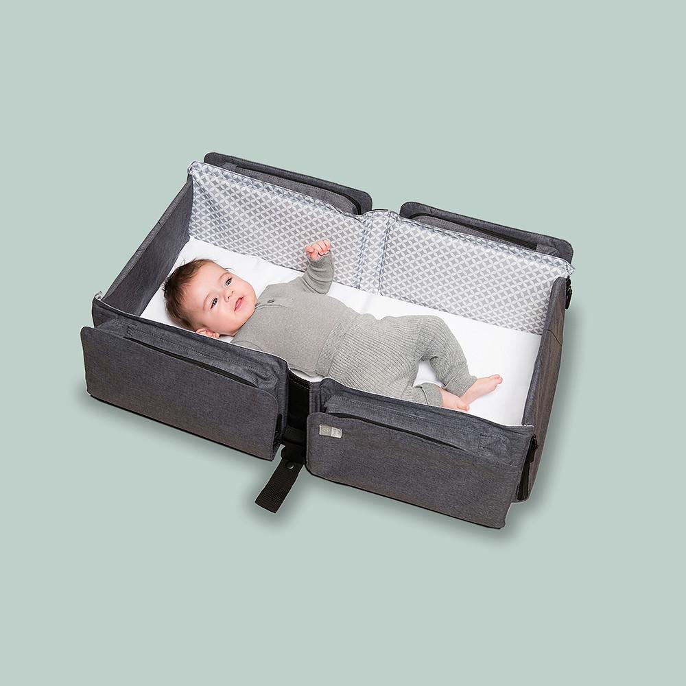 newborn baby inside Doomoo Basics Nursery Bag