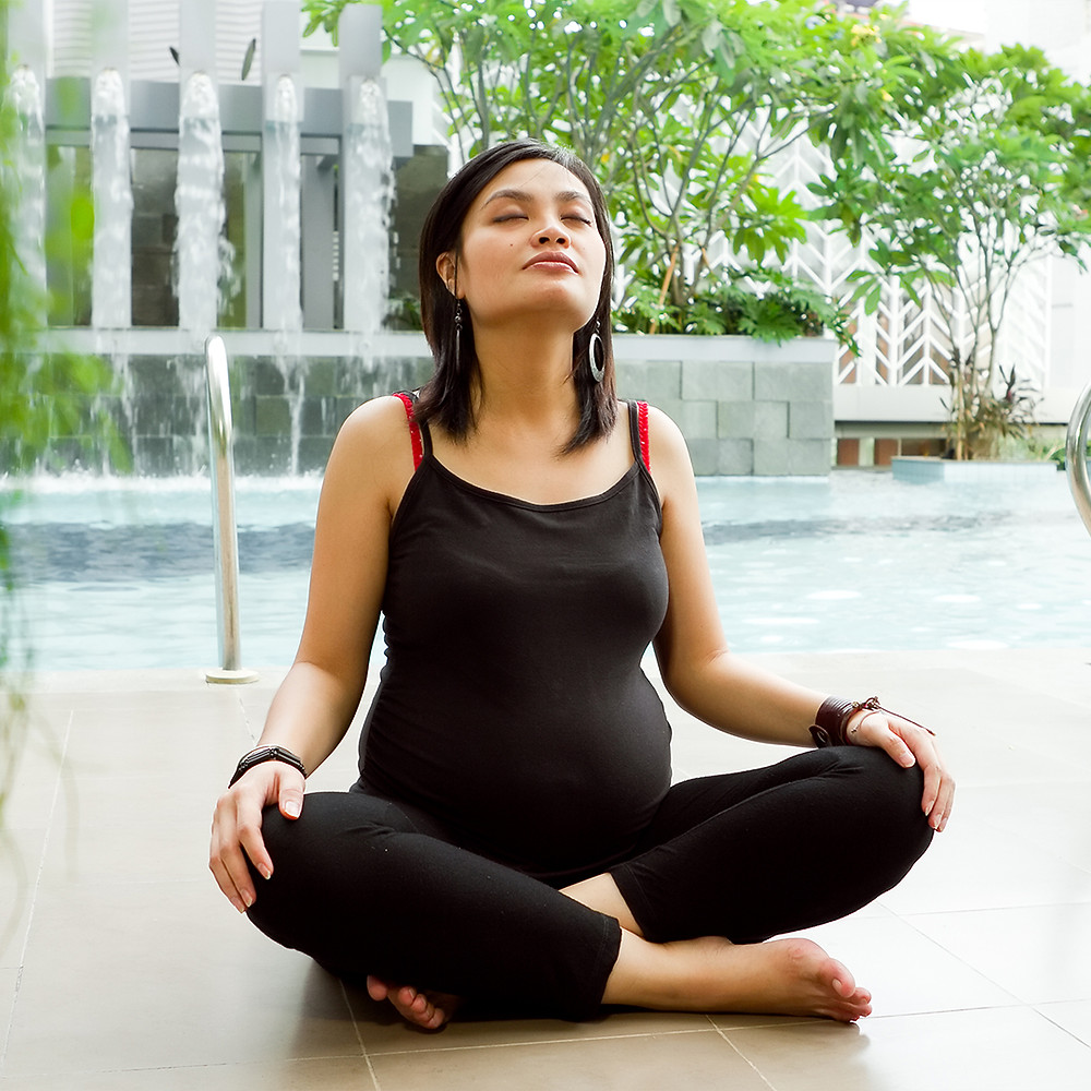 pregnant mother practicing breathing exercises