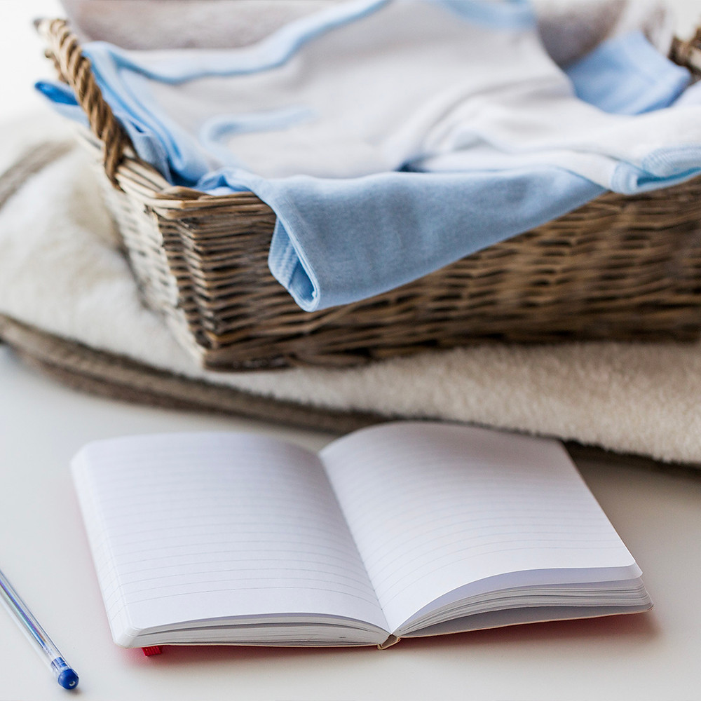 mother preparing a list for childbirth