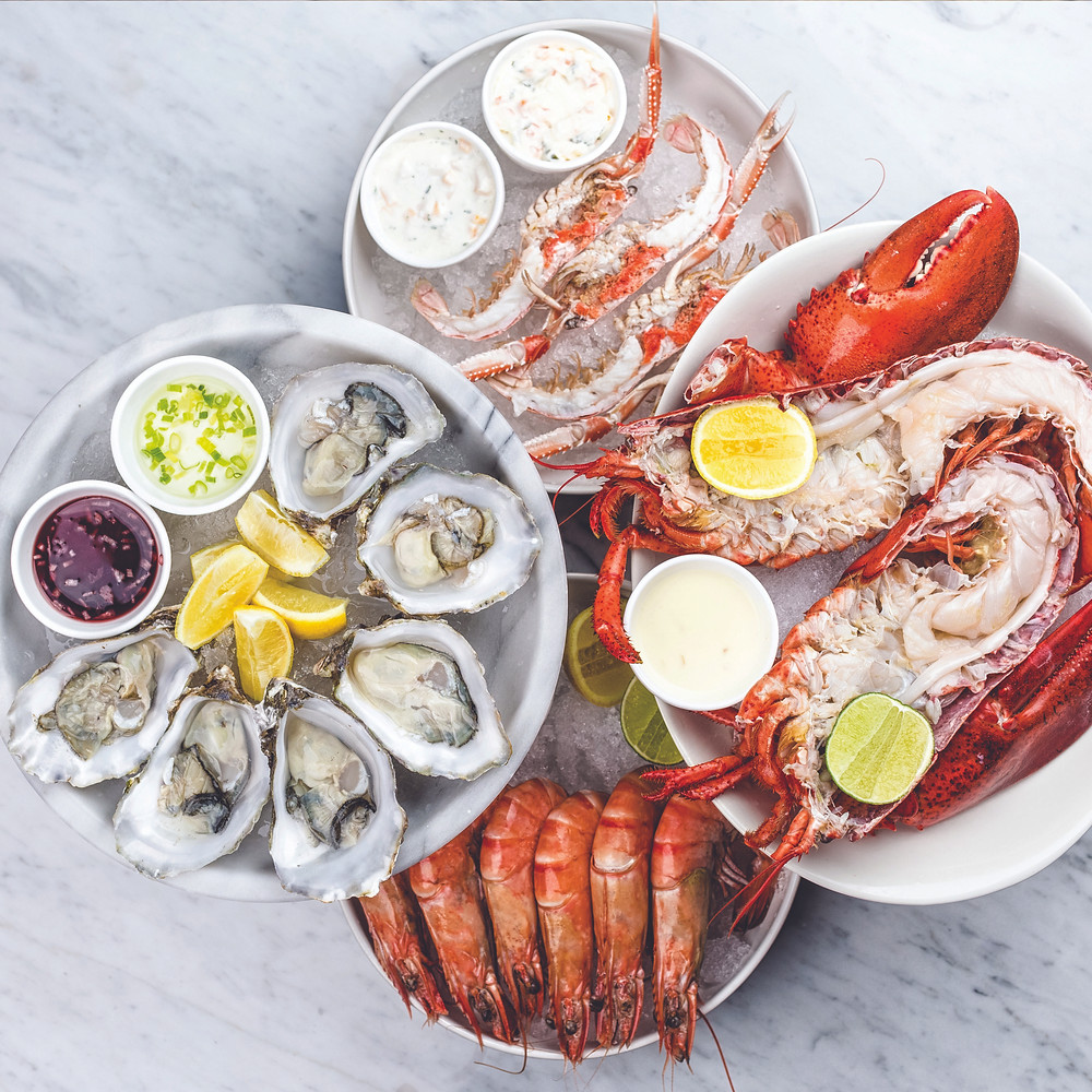 different kinds of seafood served on table