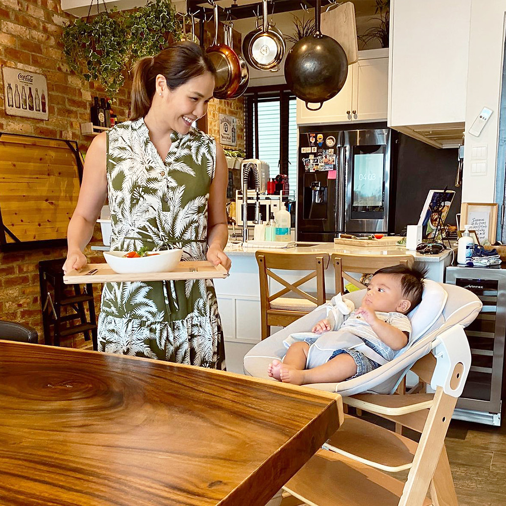 Mom preparing meal for baby in Hauck's Alpha Bouncer