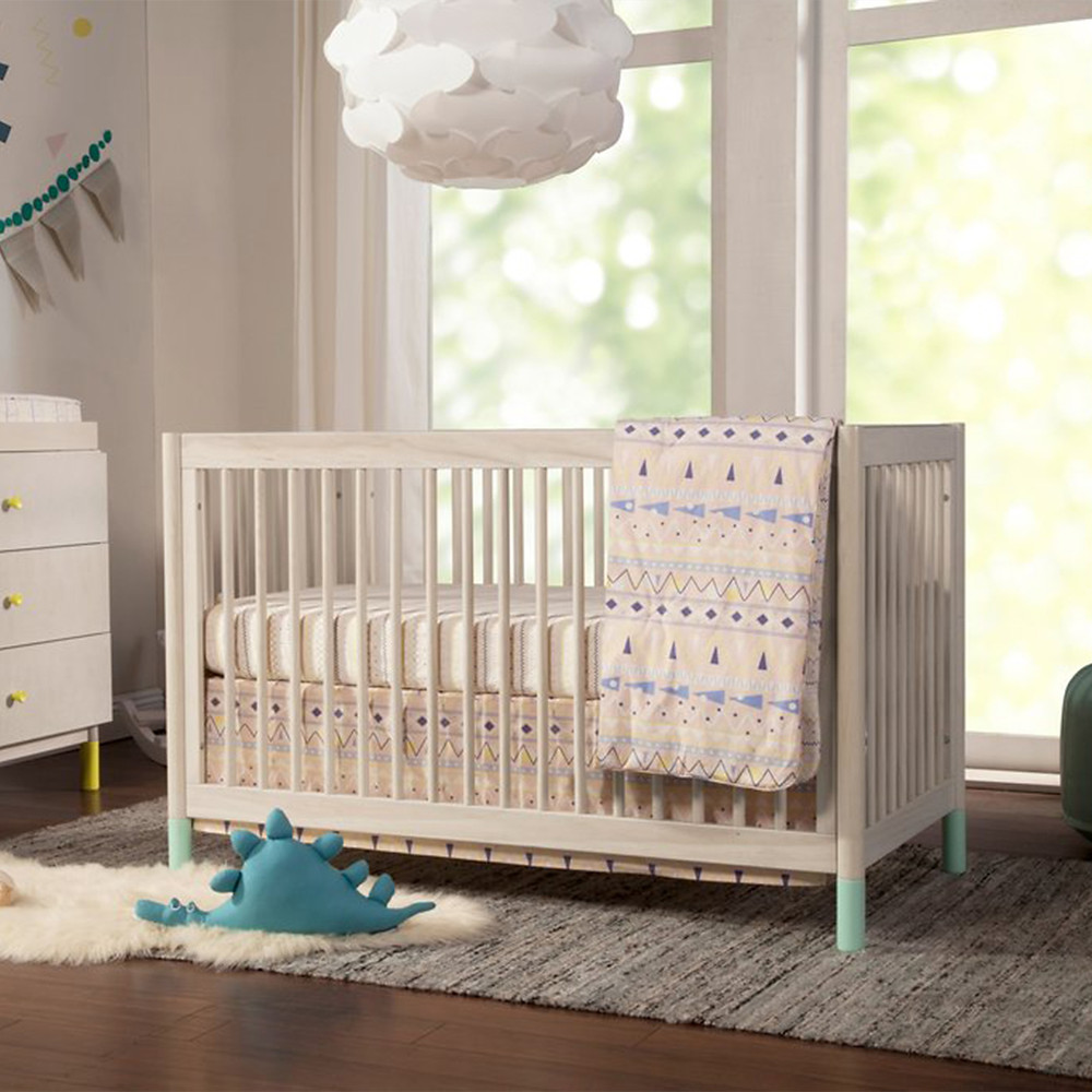 patterned theme nursery crib