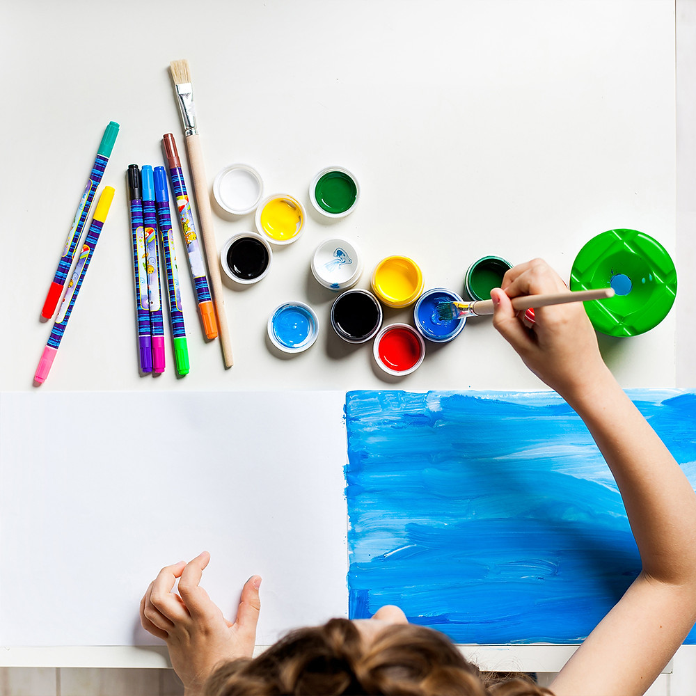 child painting on a paper