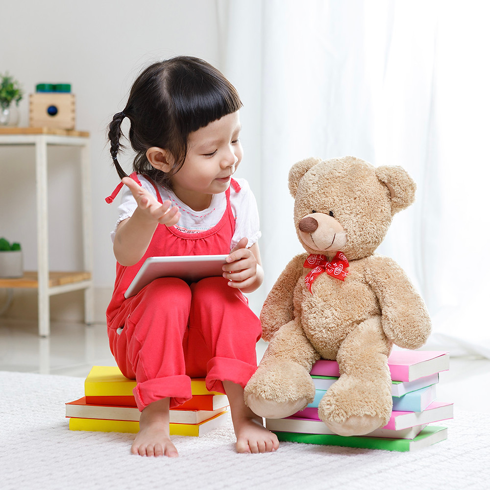 young girl playing and talking to her toys