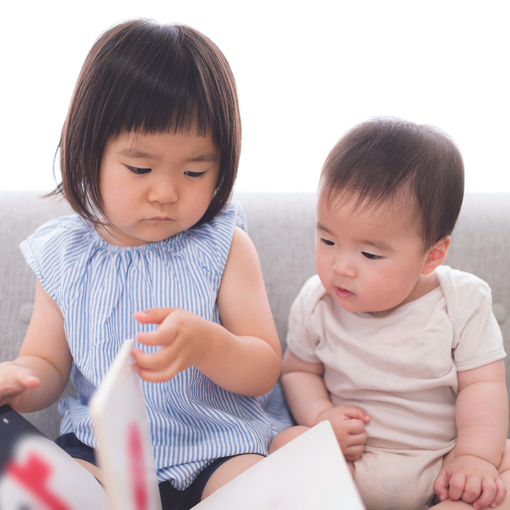 sibling reading a picture book