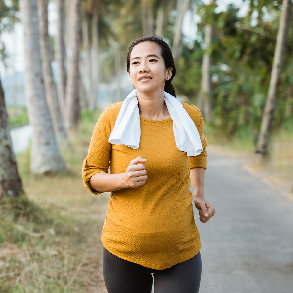 pregnant woman running outdoors