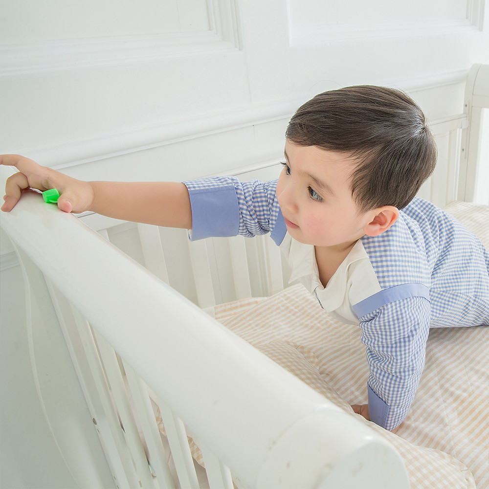 toddler outgrowing his own crib