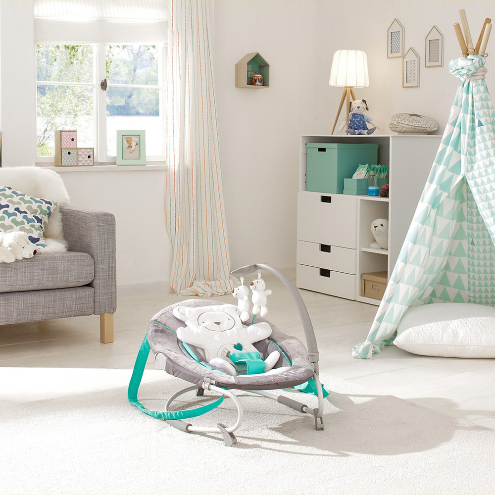 playful nursery with hauck's bouncer