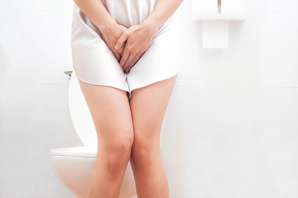 Women wearing white sleepwear standing in the toilet