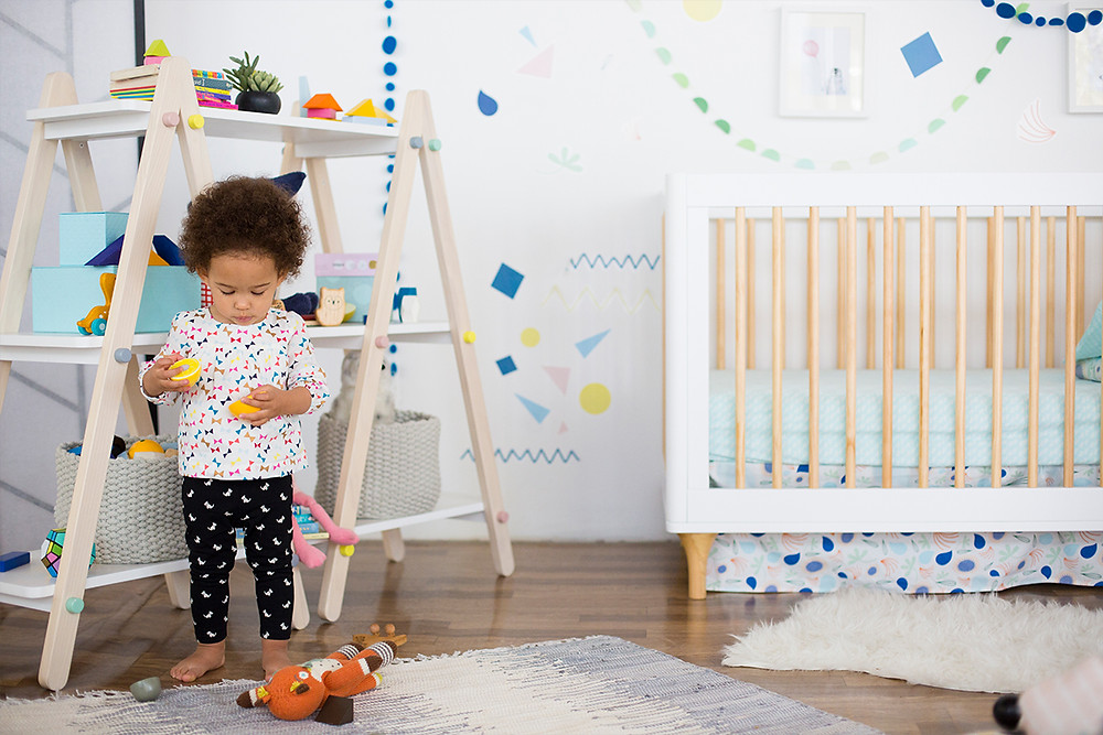 baby playing on a nursery room