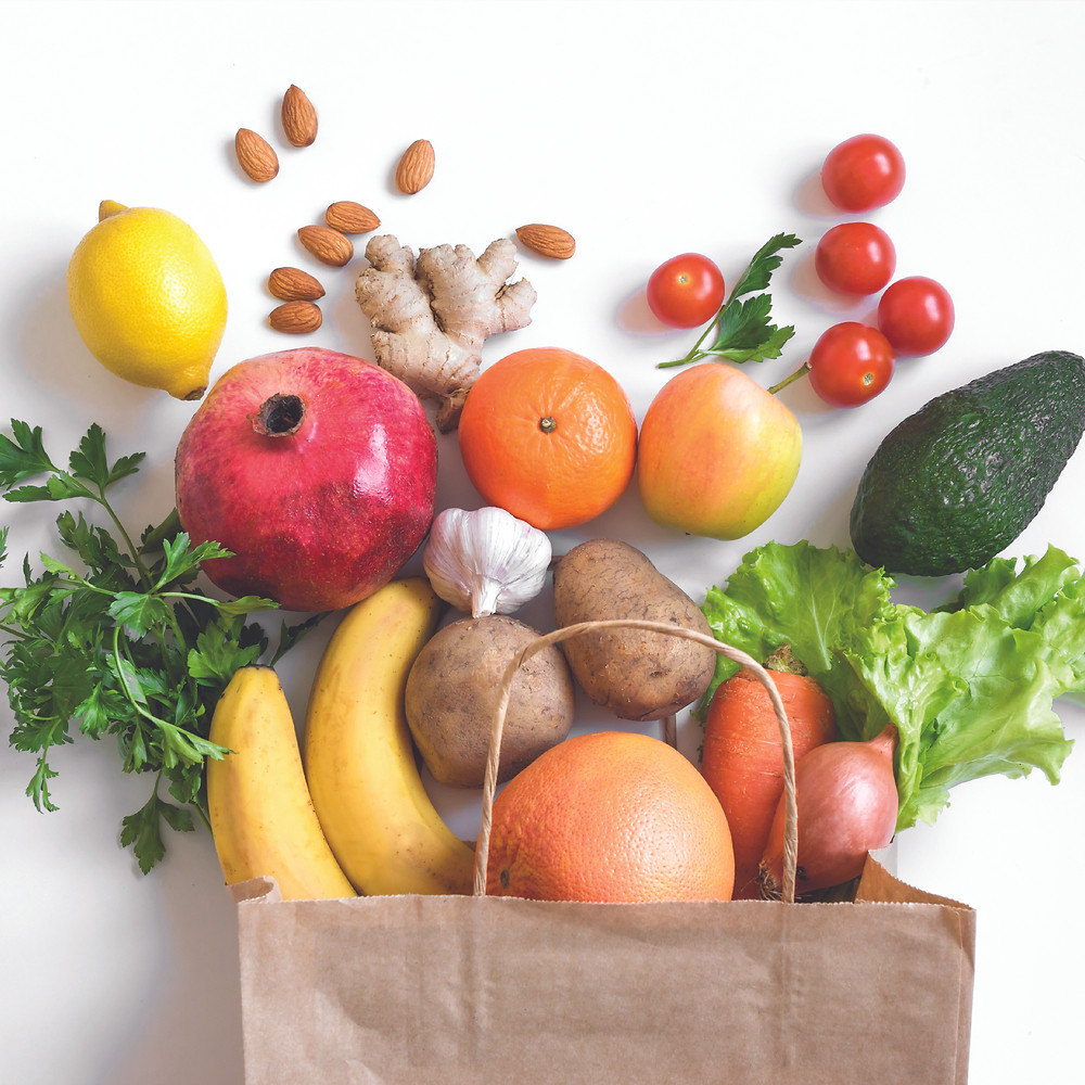 vegetables and fruits in a brown paper bag