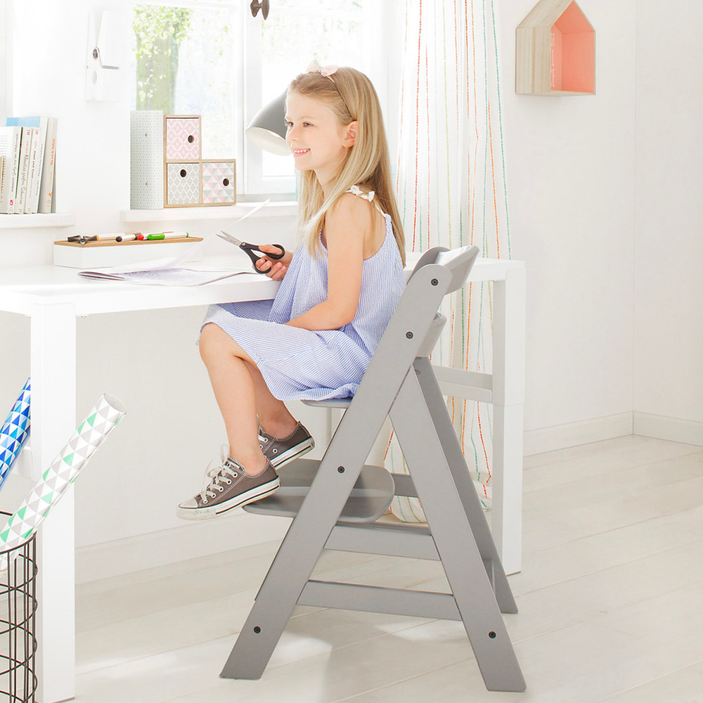 young girl sitting on her converted high chair