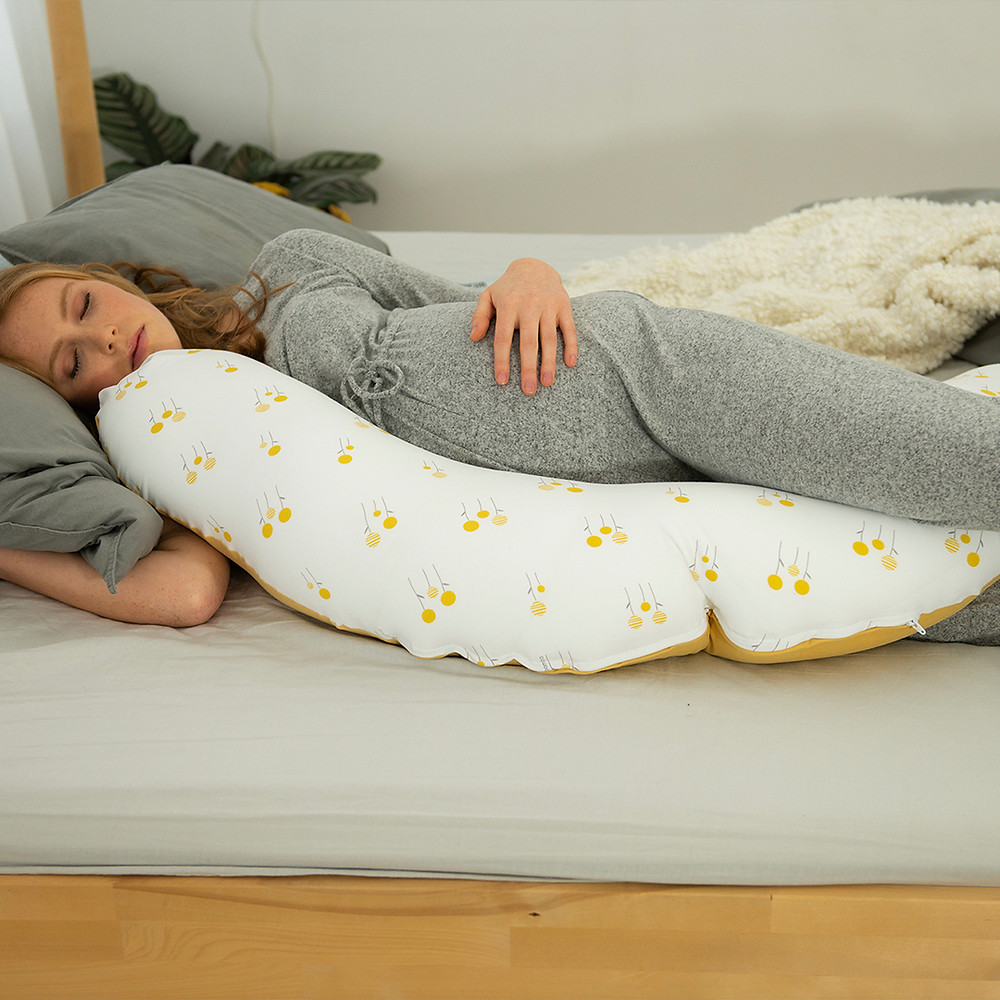 woman using Buddy Organic Cotton Multi-functional Cushion during pregnancy