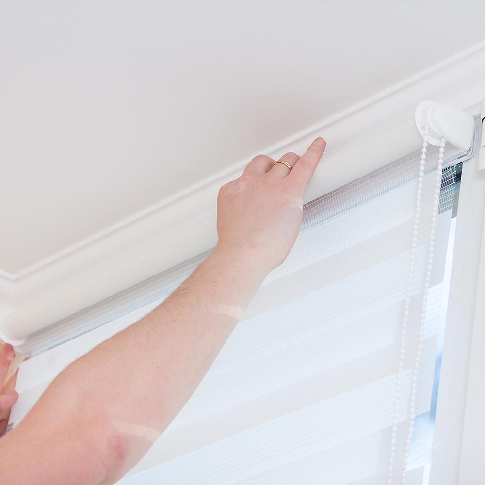 Man hands installing window roller