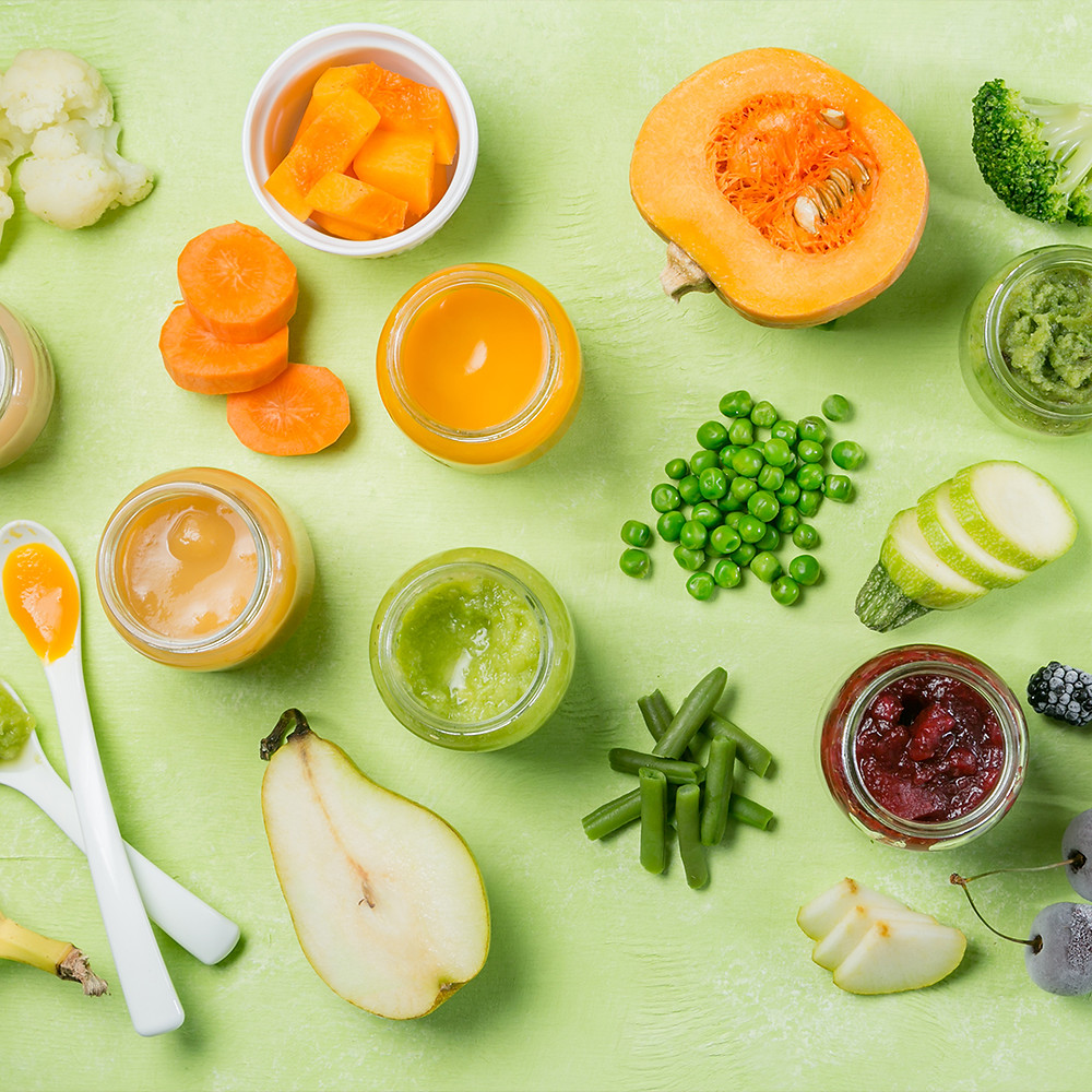 Colourful baby food purees in glass jars