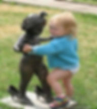 child dancing with statue.jpg