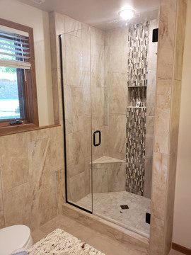 ceramic tile shower with glass door and