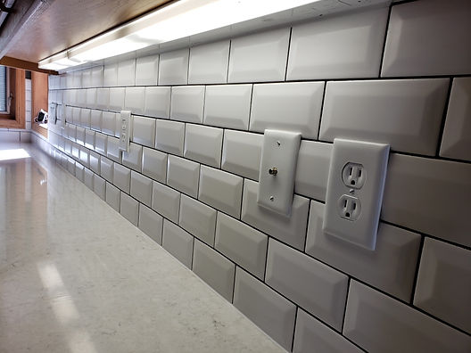 Ceramic tile backsplash with white subwa