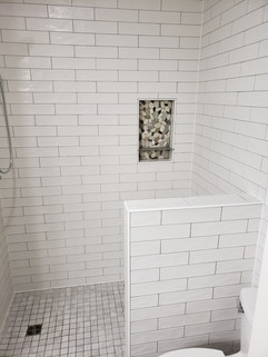 ceramic tile curbless shower with niche