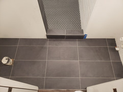 ceramic tile floor with shower curb