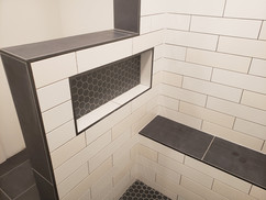 Ceramic tile shower with niche and bench