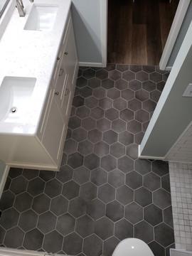 black hexagon ceramic tile floor